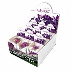 Contiene 18 Drusas de Amatista, presentadas individualmente en pequeñas cajas expositoras de 6.5x7.5 cm.  Se puede adquirir i
